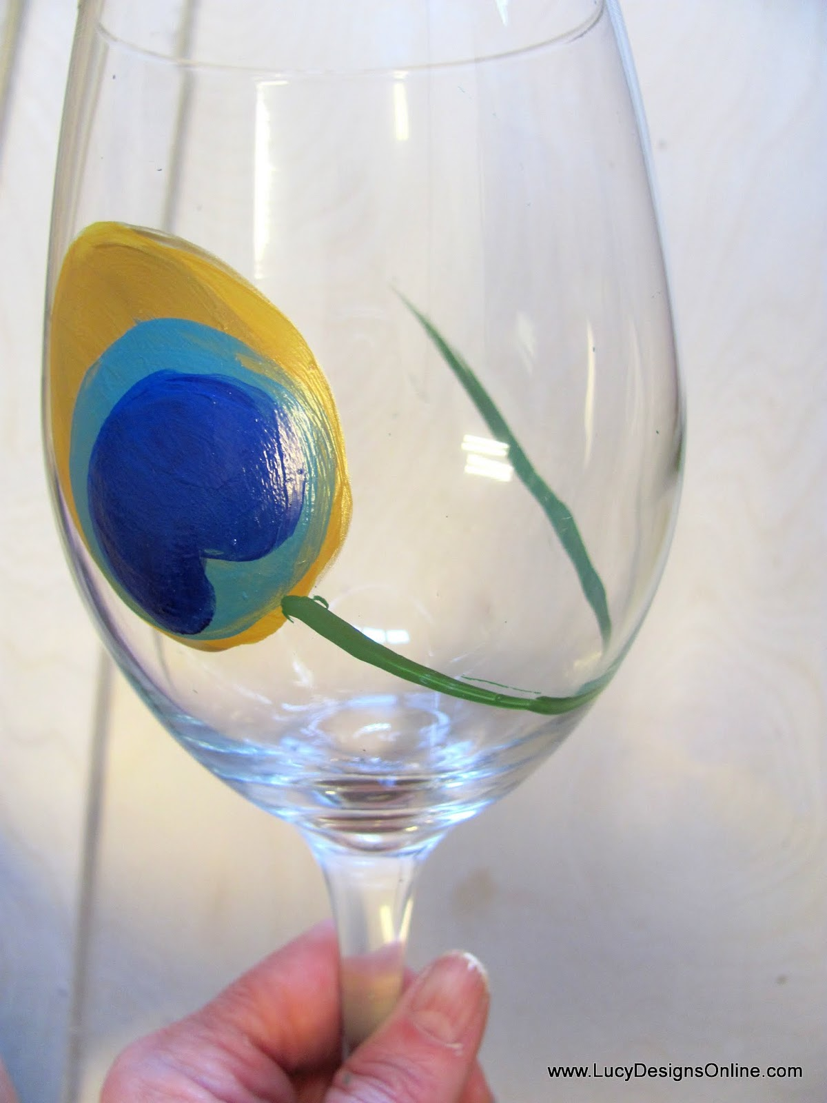 Diy hand painted wine glasses with peacock feather design for Paint vino