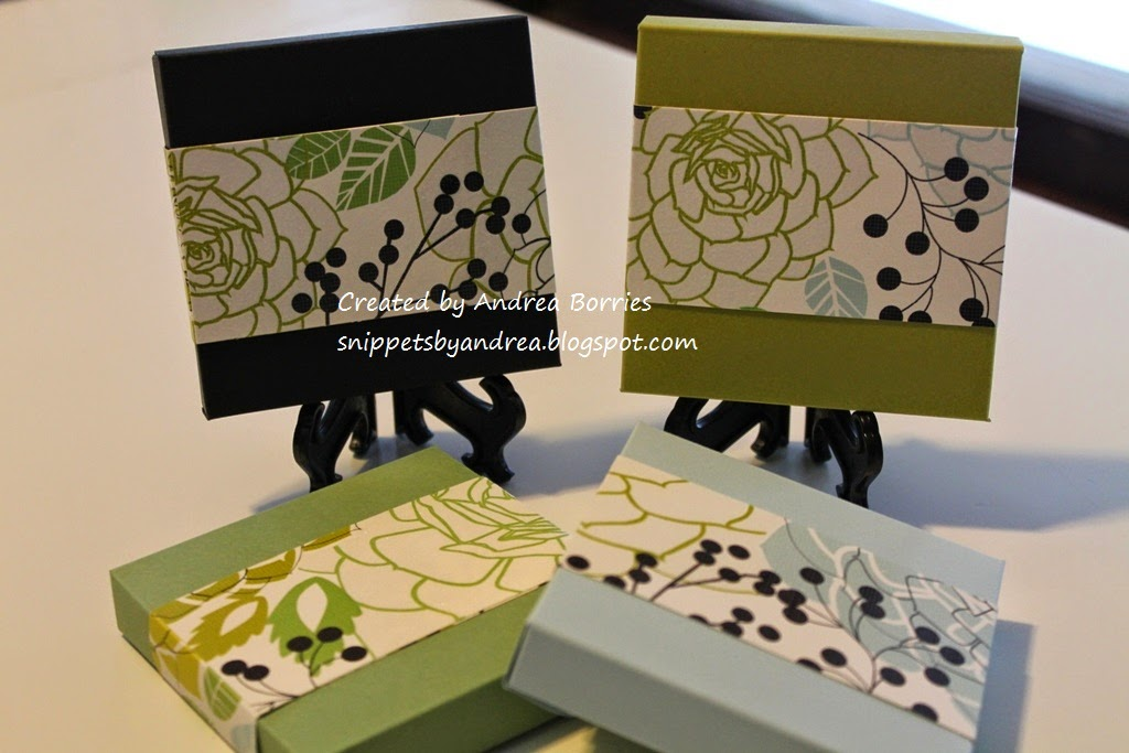 "Four card stock boxes (3-1/2"" x 3-1/2"" x 3/4"") closed with 2"" belly bands of floral printed card stock."