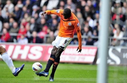Newcastle striker Papiss Demba Cissé loft the ball over Michel Vorm to score against Swansea