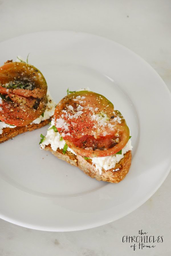 burrata (fresh mozzarella + cream) and tomato tartine - so easy, soooo good