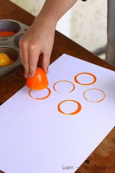 Making prints with plastic Easter eggs - fine motor art for kids