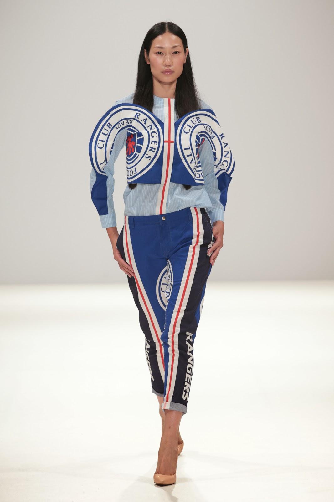 2d1e8afaa65 and a childlike interpretation of the Rangers Football club logo on a  jumpsuit.