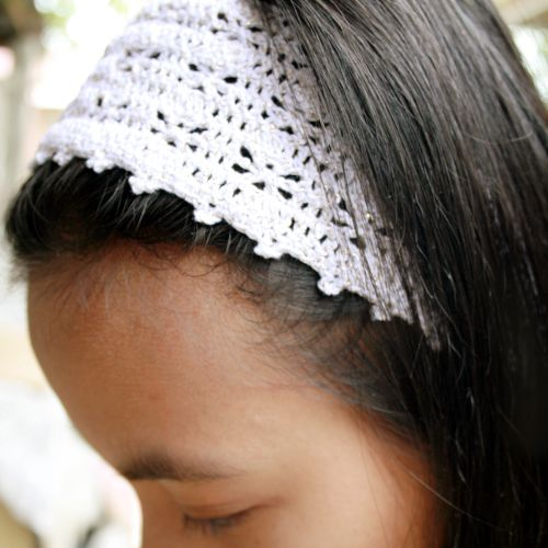 white crocheted headband