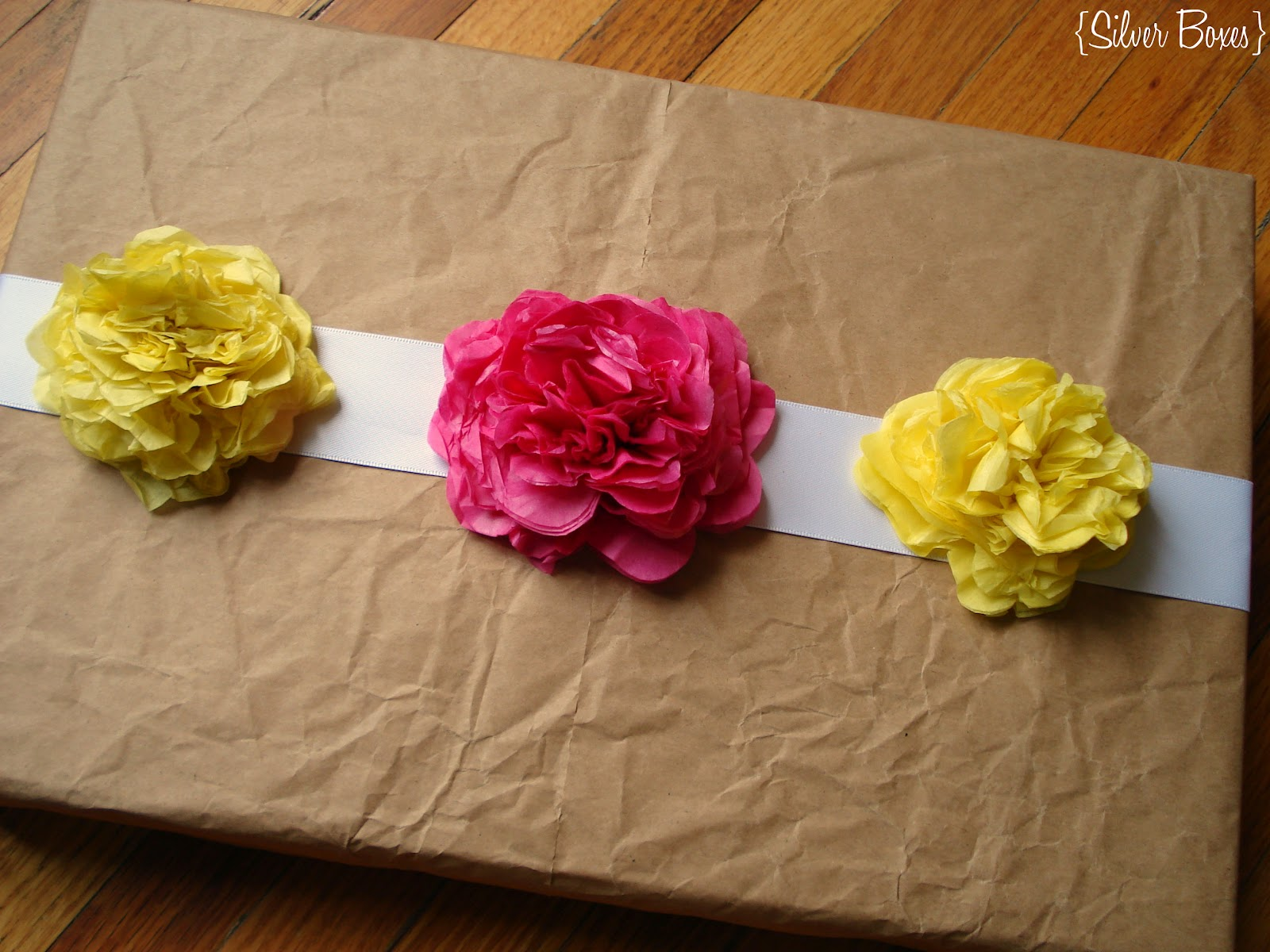 Silver Boxes Tissue Paper Flowers To Embellish A Gift Package