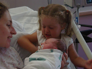 Big Sister meets Baby at hospital for first time