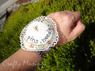 round pincushion on my wrist
