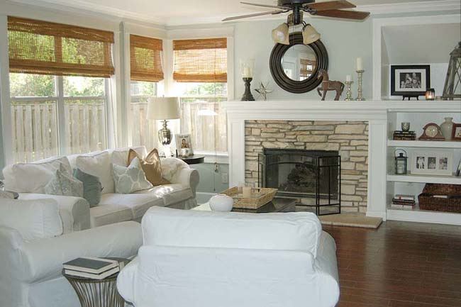 cottage style family room with white sofas