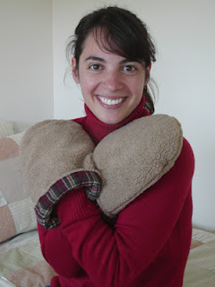 Woman using a pair of Maine Warmers' microwave Hand Warmers to warm cold hands