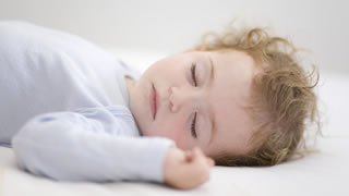 When can a Baby Sleep with a Pillow?