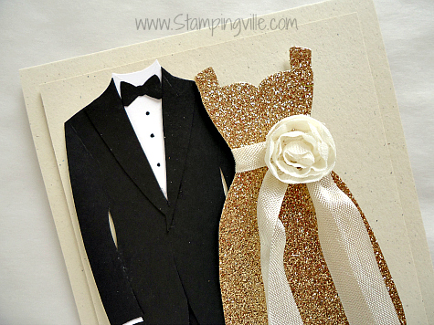 Paper tuxedo and evening gown close-up photo