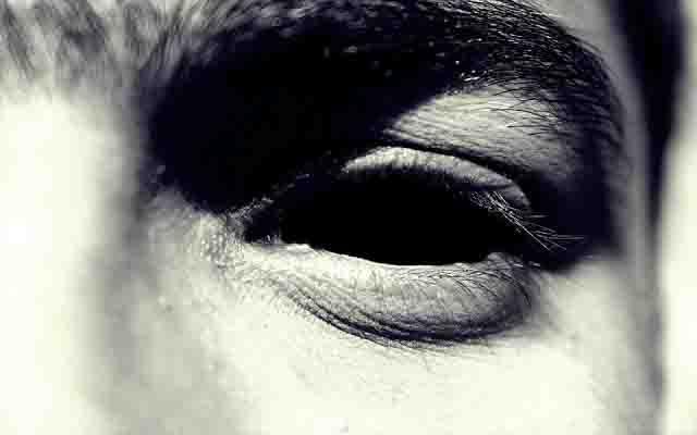 male eye black zoomed in