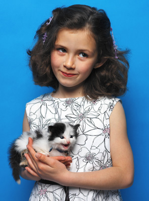 girl holding kitty