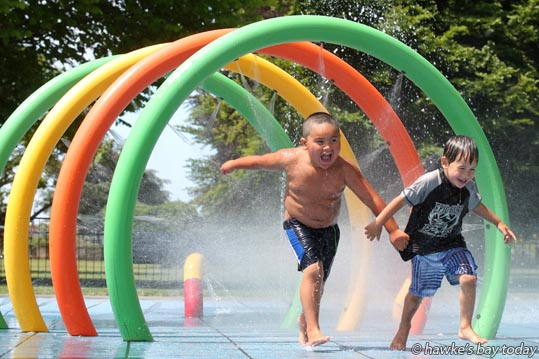 L-R: Deyton Jones, 4, Drayus Garrett-Katene, 2, enjoying the water pad at Flaxmere Park, Flaxmere, Hastings, with Te Whare Aroha o Nga Mokopuna Early Childhood Inc, Flaxmere, Hastings. photograph