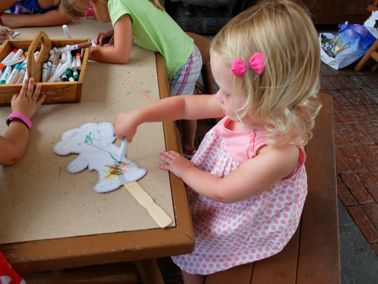 Coloring Duffy at Epcot's Kidcot Station at the American Adventure