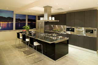 modern kitchen design in black with stainless steel countertops