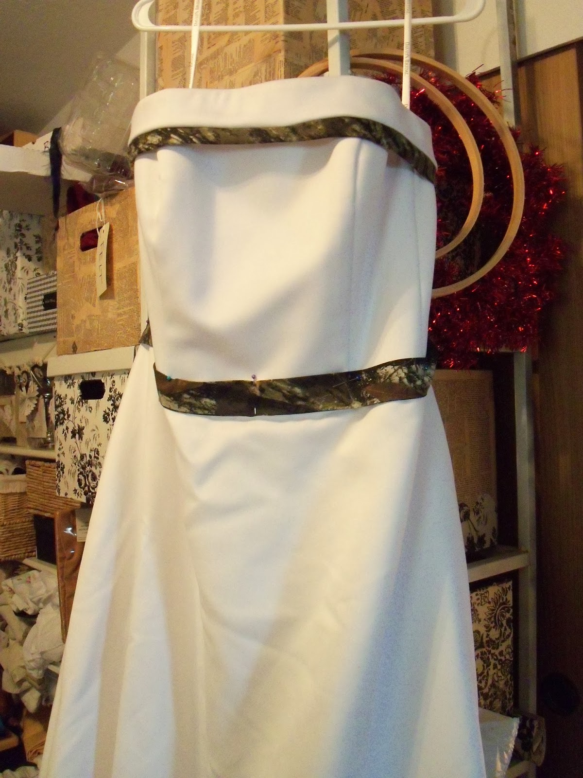 the camo wedding project white camo wedding dress Originally the bride wanted a camo print wedding dress with white satin details but after finding this beautiful gown locally we scaled it back to camo trim