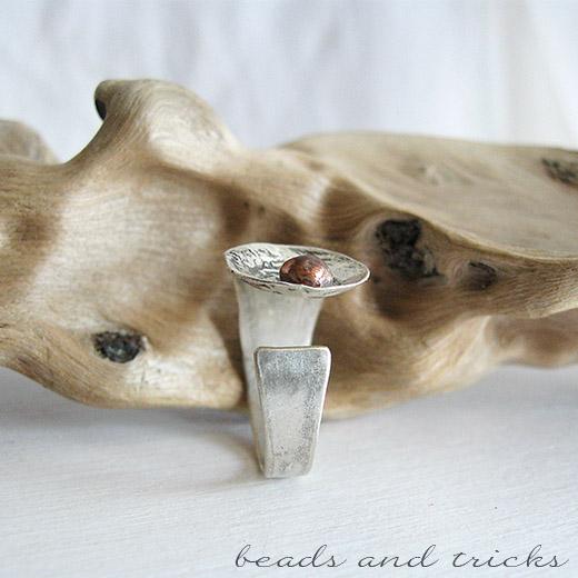 Anello a fascia in materiali di recupero: argento e rame