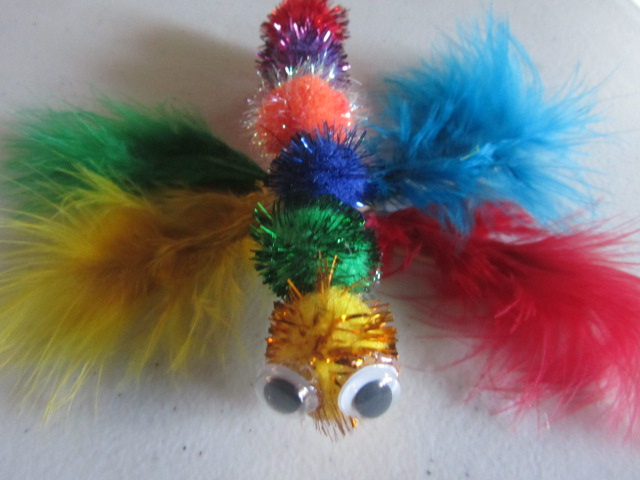 15 feather crafts for children craftulate for Feathered birds for crafts