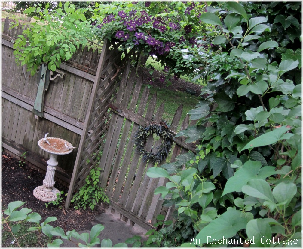 An Enchanted Cottage Garden Gate Arbor and Clematis