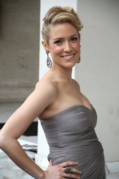 A pregnant Kristin Cavallari looked stunning as she was seen emerging from her Los Angeles condominium ahead of the 84th Annual Academy Awards in a light gray bandeau floor-length chiffon gown featuring a sweetheart neckline and draped detailing and sporting a chic up-do.