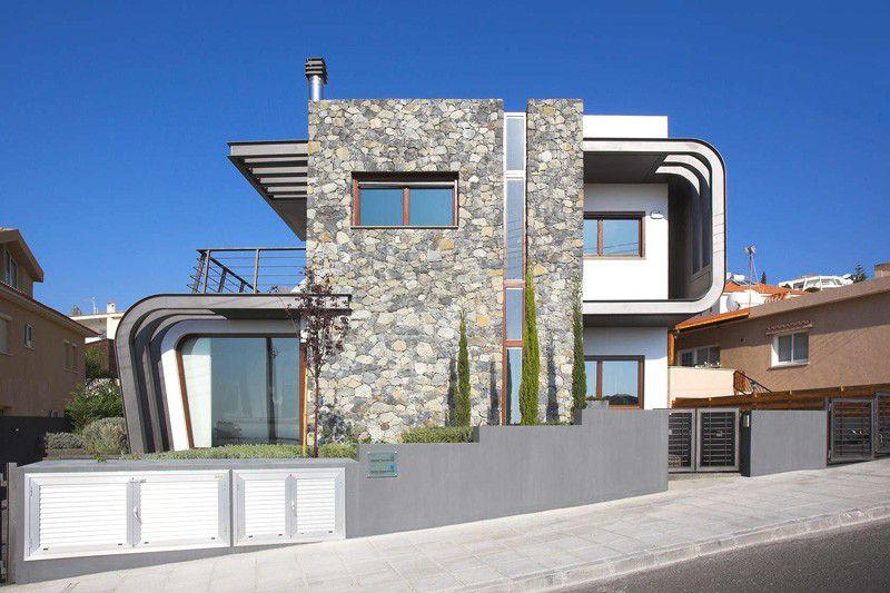 Casa moderna de estructura expuesta en chipre arquitexs for Casa moderna 8