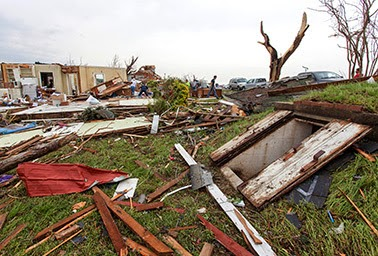 Two kinds of shelter: Some residents of Vilonia, Ark., rode out a killer tornado this week in a storm shelter (right). Those who stayed in their homes saw severe damage, but experts say some of it could have been avoided. (Credit: Karen E. Segrave / AP Images) Click to enlarge.
