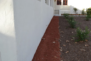 Clean Wall with Red Rock
