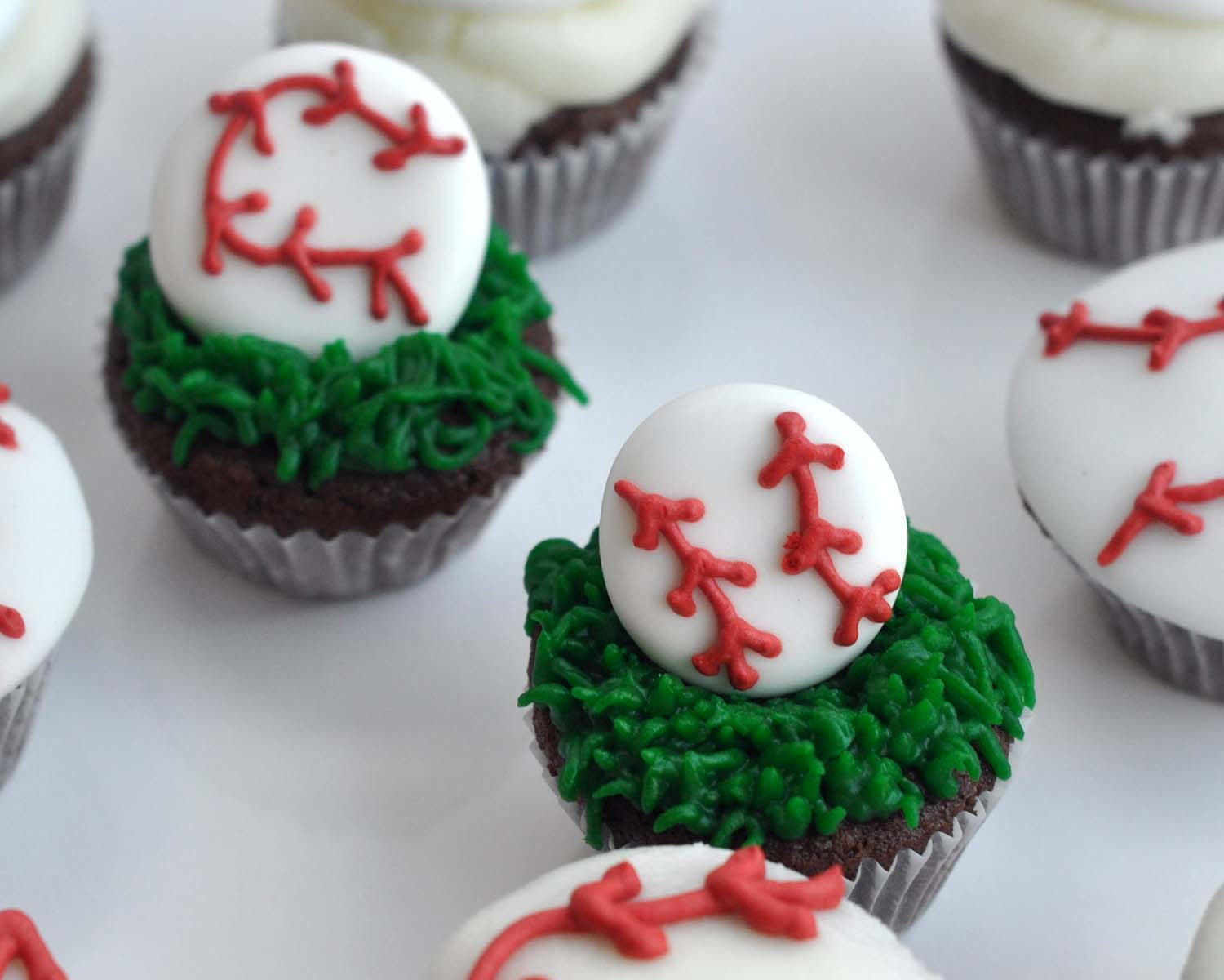 Watch How to Decorate BaseballThemed Cupcakes video