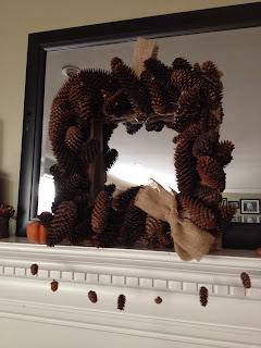 http://twoityourself.blogspot.com/2013/11/square-pine-cone-wreath-with-burlap.html