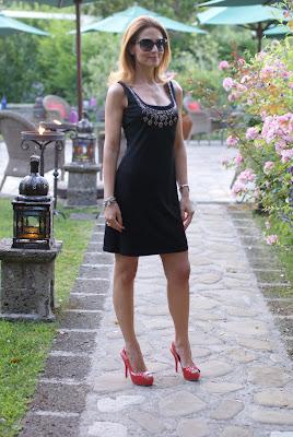 elegant black dress, coral pumps