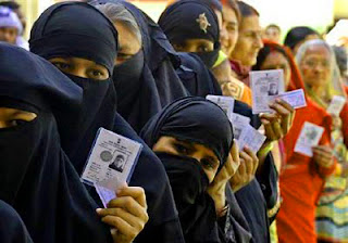 Indian Muslim Hindus standing together in line for voting in BMC eletcions in Ayodhya