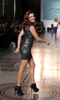 Kelly Brook in a tight dress on the catwalk
