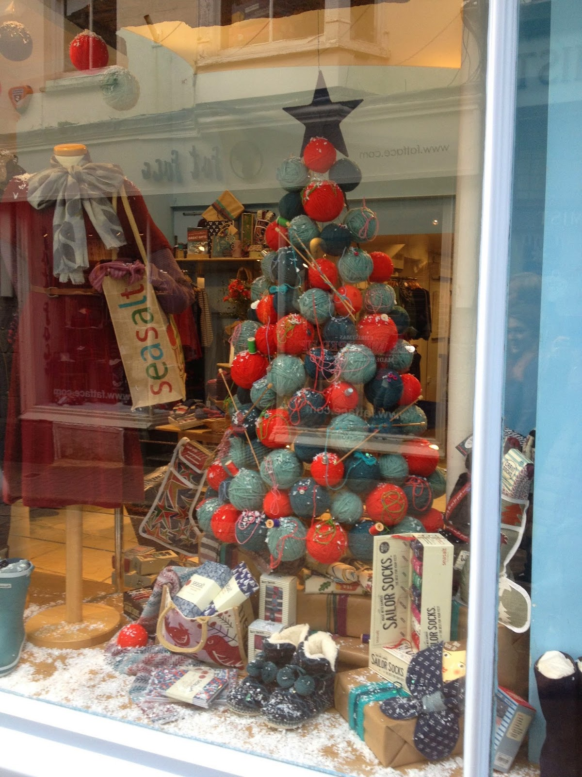 Christmas window with tree made of knitting balls