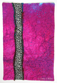 magenta quilt with black -white vertical undulating line, embroidery