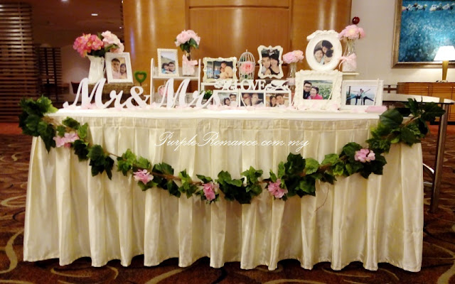 photo table, love corner, garden theme, wedding decoration, hydrangea flowers, artificial, fresh, photo album, frames, strands of grasses, pullman KLCC, grand ballroom, kuala lumpur, selangor, day, mr & mrs, initial, logo, stage backdrop, fairy lighting, dangling flowers, green carpet, bird cages, metal, spotlight, pumpkin carriage, package, custom made, customise
