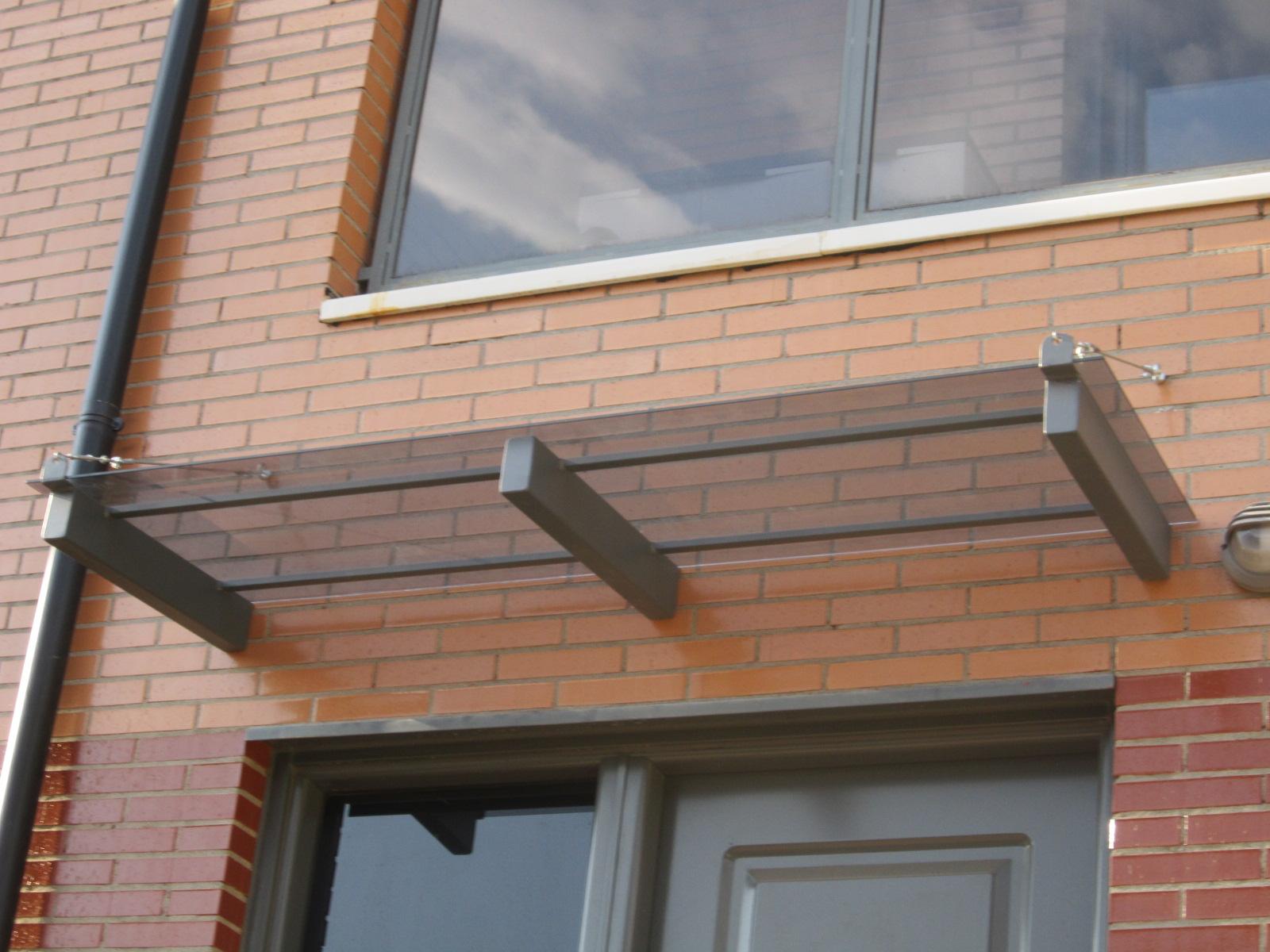 Norbel carpinteria met lica y acero inoxidable tejadillo de de hierro y cristal con tensores - Tejadillo para puerta ...