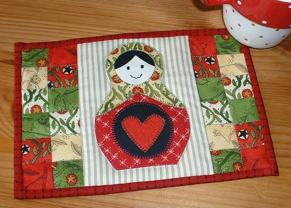 http://www.craftsy.com/pattern/quilting/home-decor/russian-doll-mug-rug/83426