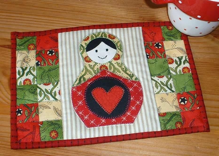 http://www.craftsy.com/pattern/quilting/home-decor/russian-doll-mug-rug/83426