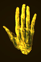 the hand of glory, gold hand on black background