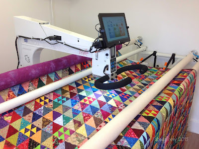 Half Square Triangle Quilt on the longarm quilting machine