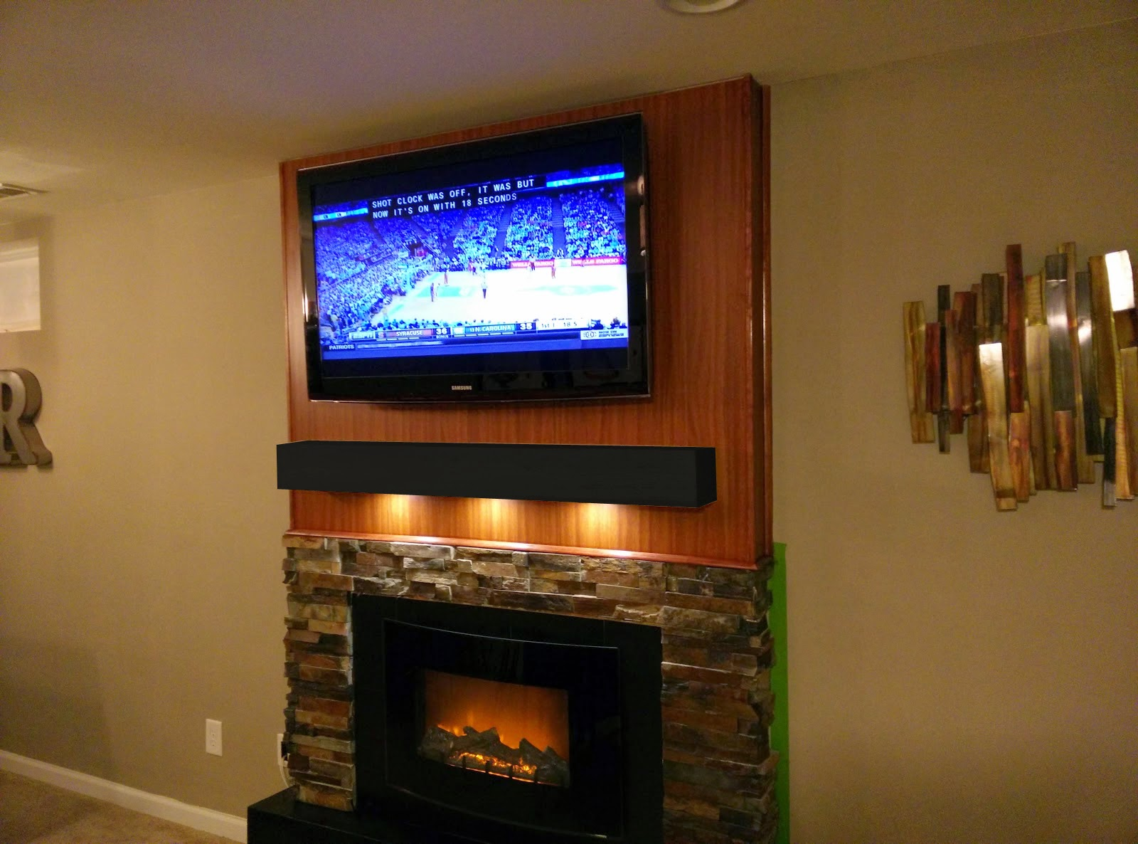 Road to the ravenna diy tv fireplace wall with stone for Diy fireplace wall ideas