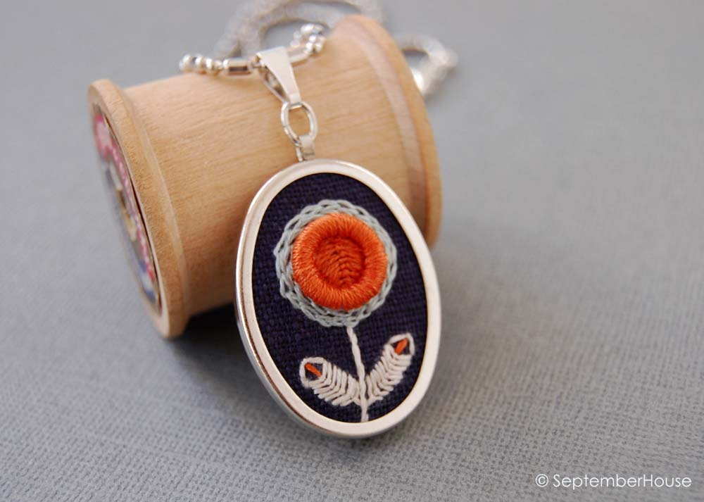 hand embroidered oval pendant necklace handmade in orange and navy