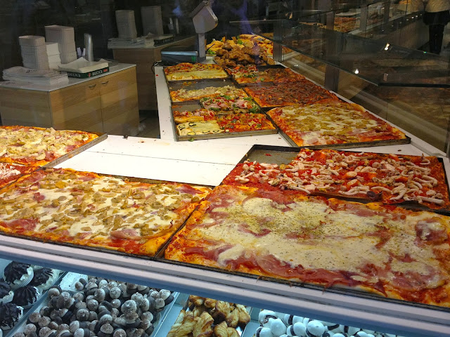 Picture of pizza in a Bergamo bakery.