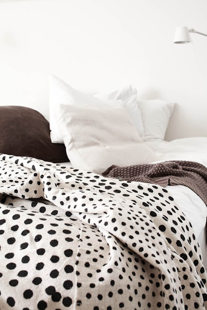 alternative photo of white bedroom with ikata polka dot duvet cover with brown pillow and sweater