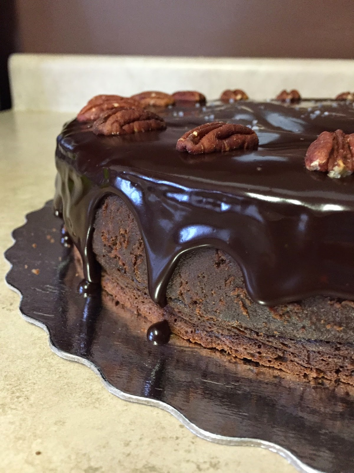 A Pecan Pie Inside a Maple Dark Chocolate Truffle Cake