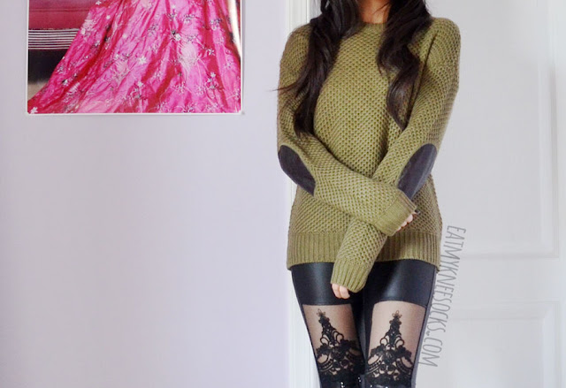 A grunge, punk-inspired outfit featuring the Cozy Up sweater from Idol Collective, Jeffrey Campbell Lita Spike platform booties dupes, and mesh lace-up faux leather wet look leggings.