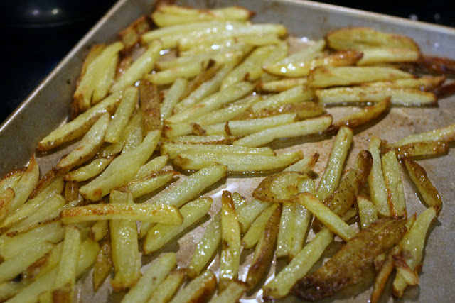 Large metal baking sheet used to bake fries in oil.