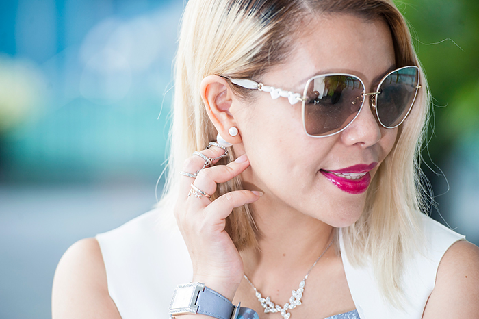 Crystal Phuong looked Charles & Keith white sunglasses, paired it with Swarovski watch and necklace.