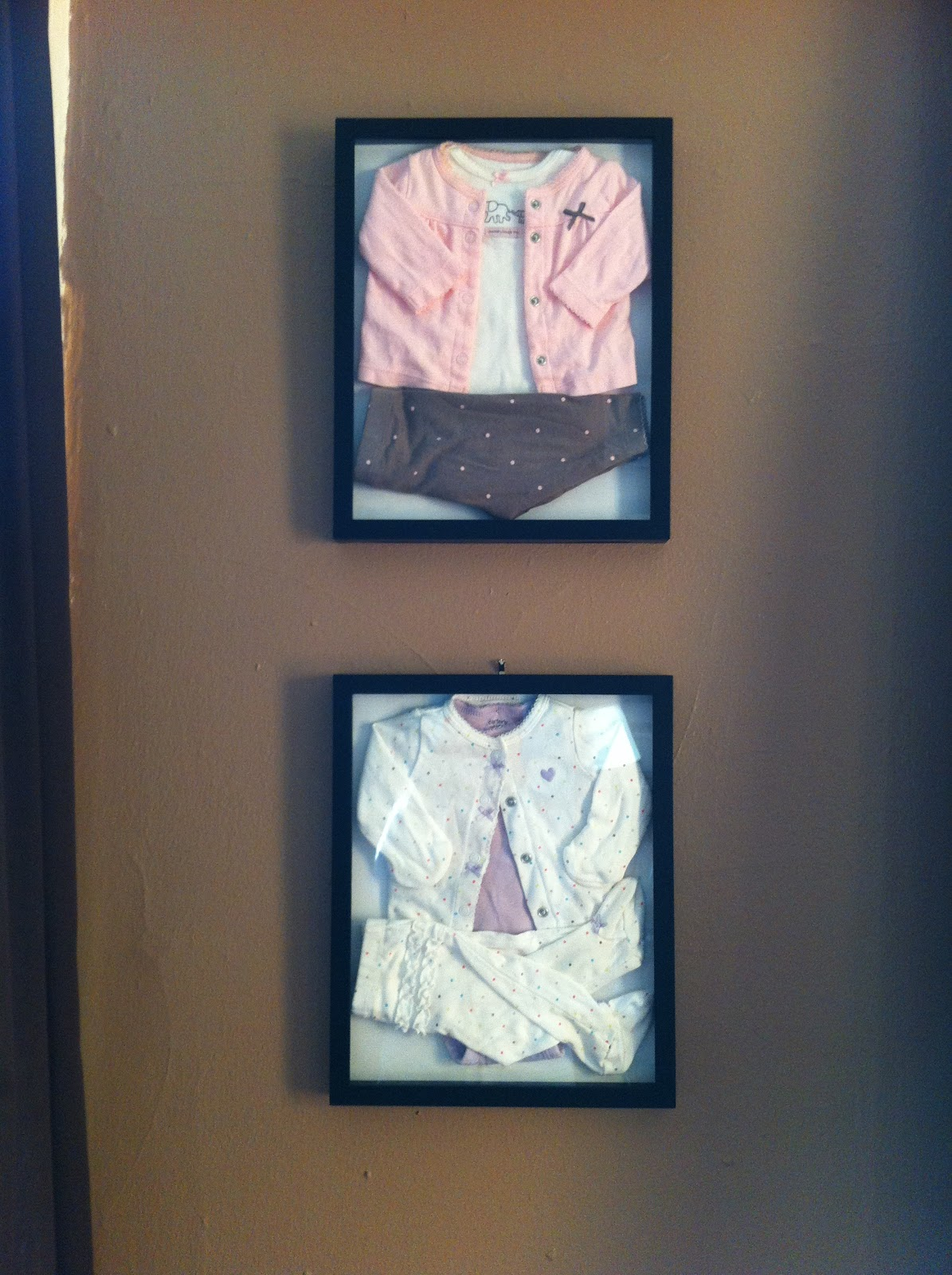 Shadow Box With Baby Clothes