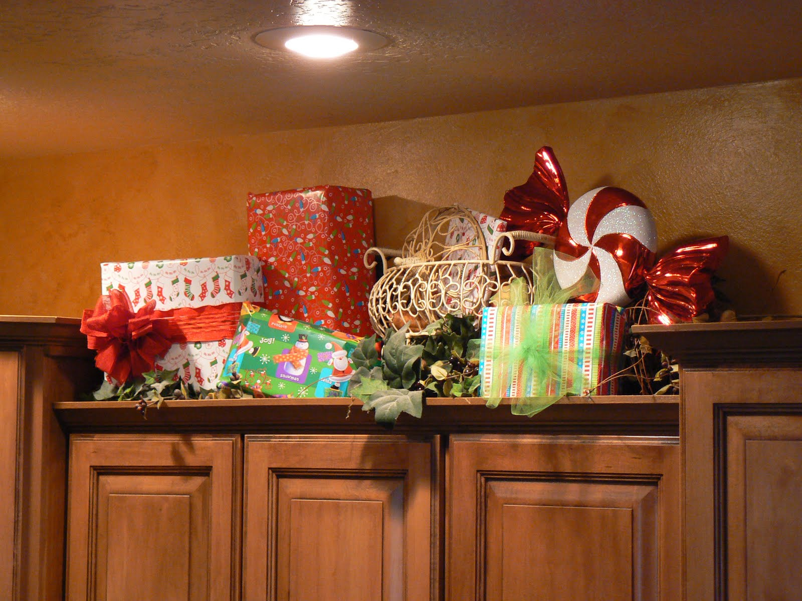 Decorations above kitchen cabinets best home decoration for A christmas decoration